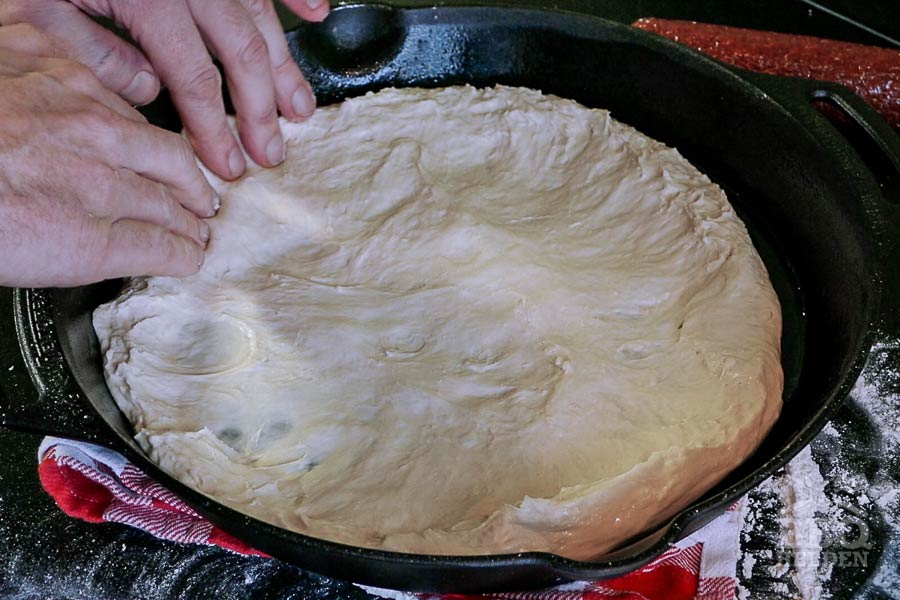 dough pussed in cast iron skillet