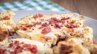 Cauliflower steaks with cheese and bacon