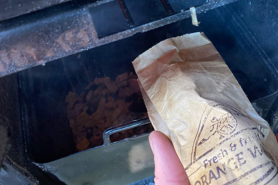 wood chips in the ashtray of the masterbuilt gravity series 560